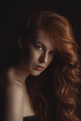 Closeup portrait of young beautiful model at studio