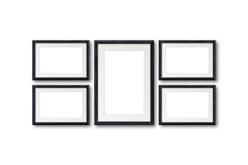 Collage of five black natural wooden photo frames on wall, interior decor mock up