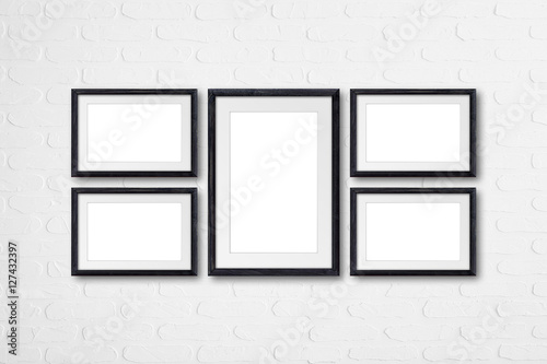 Collage of five black natural wooden photo frames on bricks wall ...