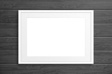 Blank frame on wooden panels wall, mockup
