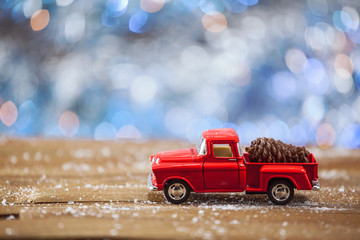 Christmas Toy Truck With On Wooden Table With Blue Background.