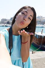 Cute happy smiling tourist girl taking self-portrait picture Heraklion Crete.
