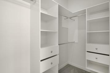 A walk in closet or wardrobe