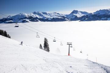 Chairlift and ski slopes in Kitzbühel ski resort in Tyrolian Alps, Austria