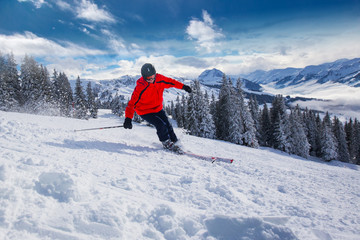 Wall Mural - Young man skiing in Kitzbühel ski resort, Tyrol, Austria