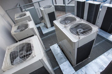 Air conditioning equipment atop a modern building - aerial/drone