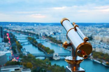 antique telescope with view over Paris