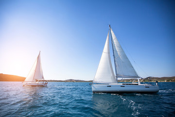 Luxury yachts at Regatta. Sailing in the wind through the waves at the Sea.