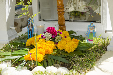 Grave decorated with flowers during Day of the dead in Oaxaca, Mexico