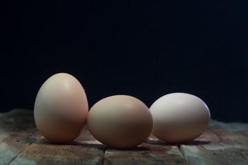 Eggs on wood background blue.