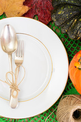 Thanksgiving table setting  with autumn pumpkins , cutlery and n