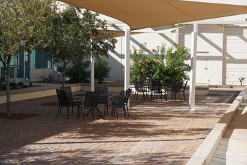 shielded outdoor steel lunch tables and chairs outside office building