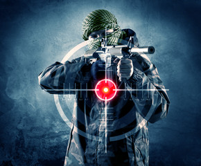 Masked terrorist man with gun and laser target on his body