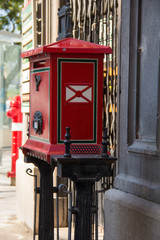 Antique old red post office box on street