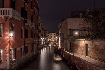 Venice - channel with little bridge at night