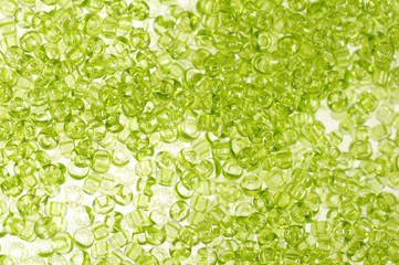 Green glass beads background - closeup beads texture