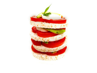 Healthy food - sandwiches, rice crackers with tomato, avocado and mozzarella cheese