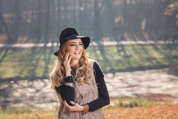 Winter portrait of a blonde hippie woman wearing a hat