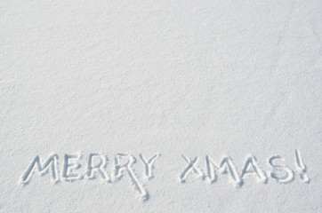 Merry Xmas letters handdrawn on flat snow surface. Nice horizontal holiday postcard, greeting card template. Empty space for copy, text, lettering.