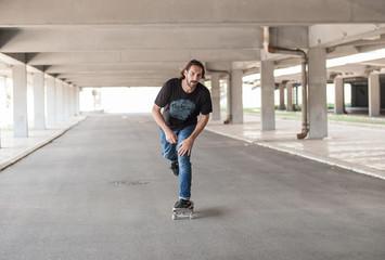 Professional skateboarder in underground passage