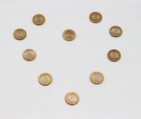 Ten rupee coin of India. Love pattern design.