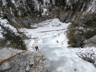 an ice climber rappels off an Ice fall in the Italian Alps in the Serrai di Sottoguda