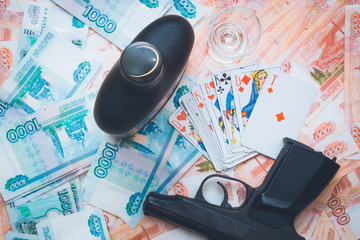 The gun and playing cards Russian big money