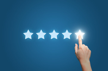 Businesswoman pointing five star to increase