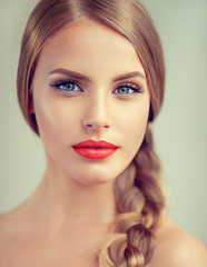 Beautiful young woman  with braid and red lips . Fashion ,beauty and cosmetics