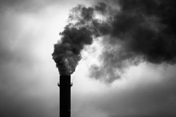 Environmental Damage: Air Pollution. The black smoke of the pipe.