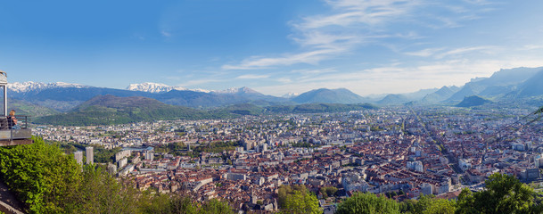 View of the City of Grenoble and the Alps from the observation deck fanikular. Panorama with dramatic city and the snow-capped Alps, the 4 frames.