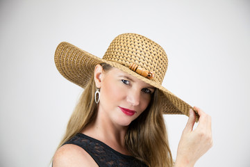 Blonde Female Holding Tip of Hat