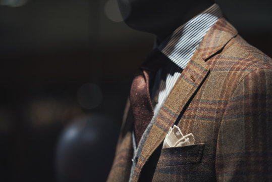 Suit in a showcase of a luxury store