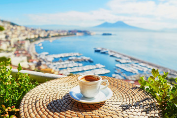 Fotorolgordijn Napels Cup of coffee with view on Vesuvius mount in Naples