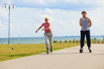 Teenagers together on skates.