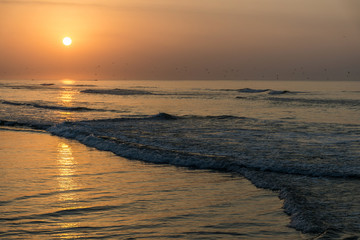 Amazing Sunset red waves at beach Salalah Oman 8