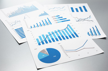 business documents graphs and charts documents on gray reflection background - Business Documents
