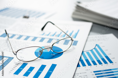 Pile Of Reports : Quot checking business reports glasses and pile of documents