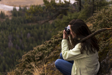Woman taking picture of landscape  green forest