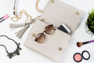 Fashion woman handbag with cellphone, makeup and accessories Wall mural