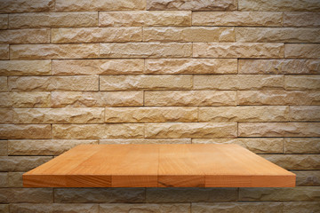 Empty top wooden on stone wall background. Can put your products for display.