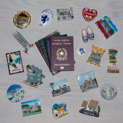 collection of various passports and souvenir magnets from several world country , Flat lay