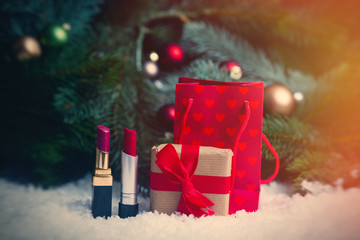 Shopping bags and christmas gifts with makeup lipstick