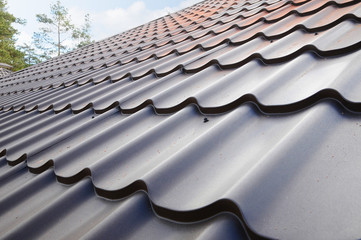 Roofing materials. Metal House roof. Closeup House Construction Building Materials. Roof construction.