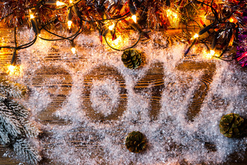 """The inscription """"2017"""" in the snow. Sign were illuminated by Garlands."""