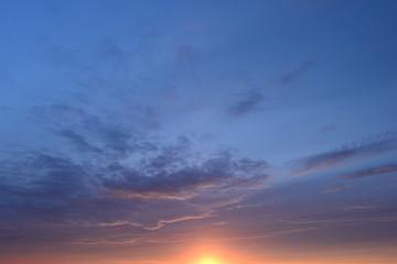Azure blue sky in the light of sunset