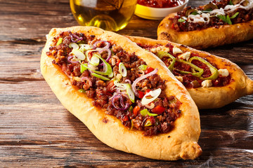 Turkish pide pizza loaves with oil