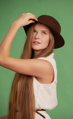 Young woman in a brown hat.
