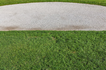 Gravel walking path in a grass field of a garden