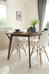 wooden table and retro style chair in dinning room in home